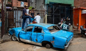 A burnt-out car in Caracas. Thirty people have died in the violence, which broke out on 20 April. Nicolas Maduro, the president, blames the crisis on rightwingers and foreign interests.