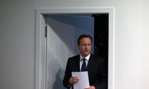 David Cameron arriving for his press conference.
