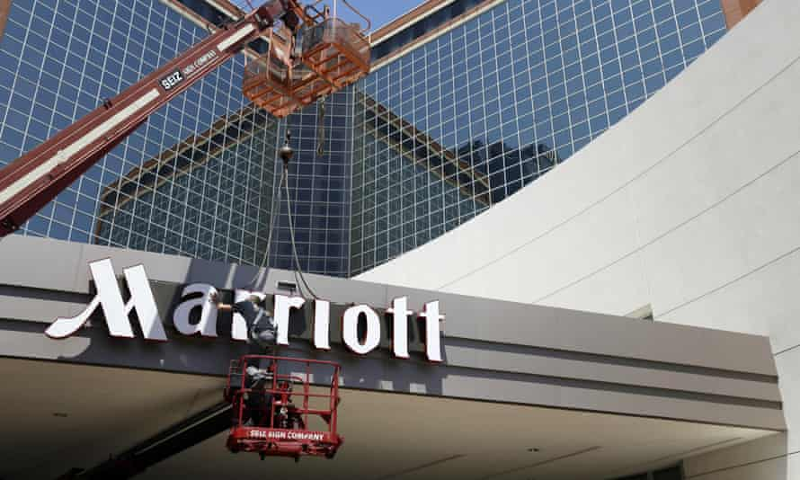 A man works on a new Marriott sign
