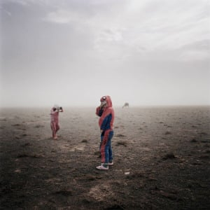 Gone with Dust, 2012-13. Michele Palazzi's striking image shows a young boy and his sister during a sand storm in the Gobi desert, Mongolia.