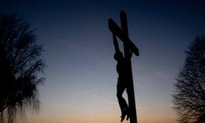 A wooden crucifix during sunset