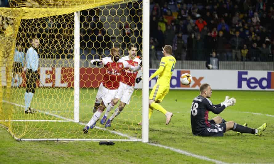Alexandre Lacazette celebrates scoring but the linesman's flag is raised