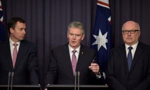Justice minister Michael Keenan, Asio director general Duncan Lewis and attorney general George Brandis at the press conference to announce the new terrorism threat rating system in Canberra on Thursday.