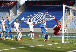 Iceland goalkeeper Hannes por Halldorsson looks helpless as a free-kick from Kieran Trippier goes just round the post.