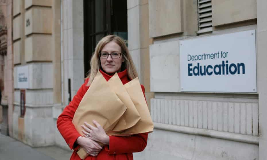 Laura McInerney and documents, outside the Dept. for Education
