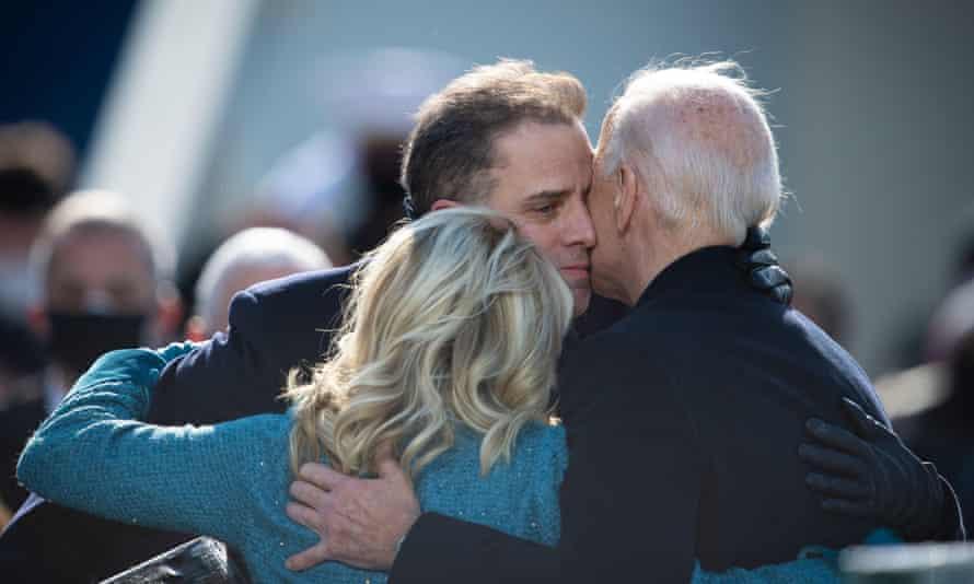 Hunter Biden embraces Jill and Joe Biden at the president's inauguration in Washington on 20 January.