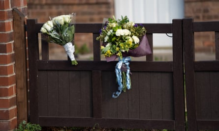 Flowers left outside the house where the 12-day-old baby was attacked.