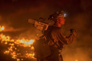 Firefighter Jesse Kaplanis battles the Valley fire in Lower Lake