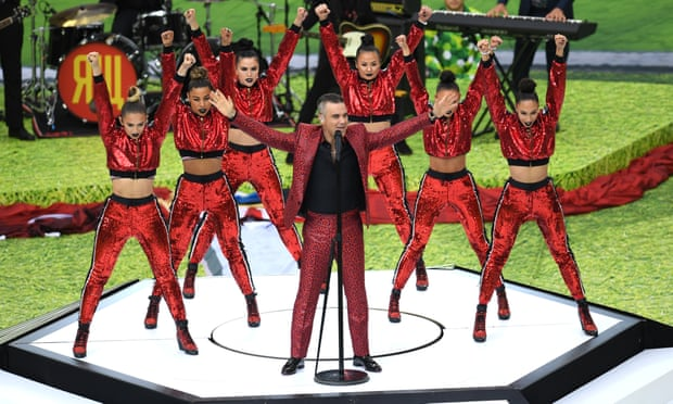 Robbie Williams performs in the opening ceremony.