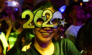 A woman smiles during New Year celebrations in Manila.