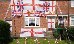 A home adorned with the St George and Union flags