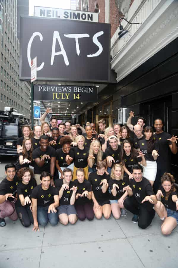 Leona Lewis and the cast pose outside the theatre.