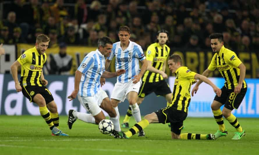 Malaga's Jérémy Toulalan is challenged by Borussia Dortmund's Sven Bender during the 2013 Champions League quarter-final that Dortmund won