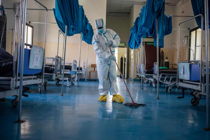 A medical staff worker is seen in the intensive care unit at De Martini hospital.