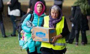 Volunteers in head scarfs make arrangements of drinking water for the worshipper of a Friday mass prayer in Hagley Park.