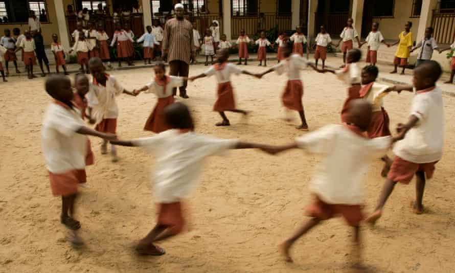 Children dance in a circle during breaktime, primary school, Lagos, Nigeria.