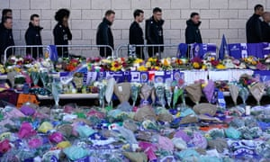 Leicester players pay their respects at the sea of tributes to the victims of the helicopter crash at the King Power Stadium