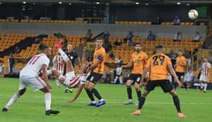 Olympiakos' Ahmed Hassan shoots with an overhead kick.