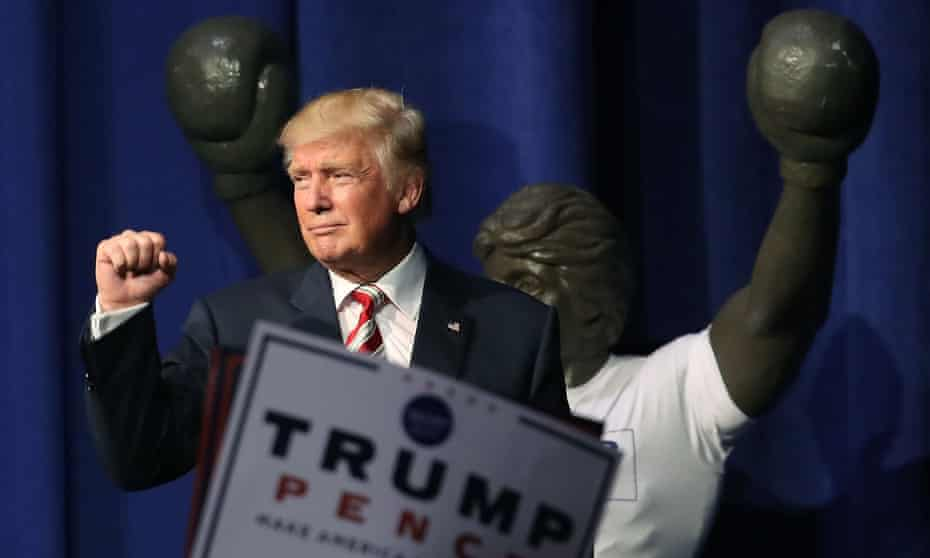 Donald Trump gestures to a crowd in Aston, Pennsylvania