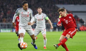 Virgil van Dijk (left) keeps a close eye on Leon Goretzka as Liverpool expertly contained the Bayern Munich threat at the Allianz Arena.