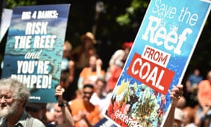 Protesters hold banners outside the headquarters of the Commonwealth Bank to say no to coal expansion on the Great Barrier Reef