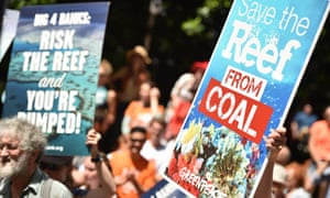 """Protesters hold banners outside the headquarters of the Commonwealth Bank to say no to coal expansion on the Great Barrier Reef as part of """"Global Divestment Day"""" in Sydney on February 13, 2015."""