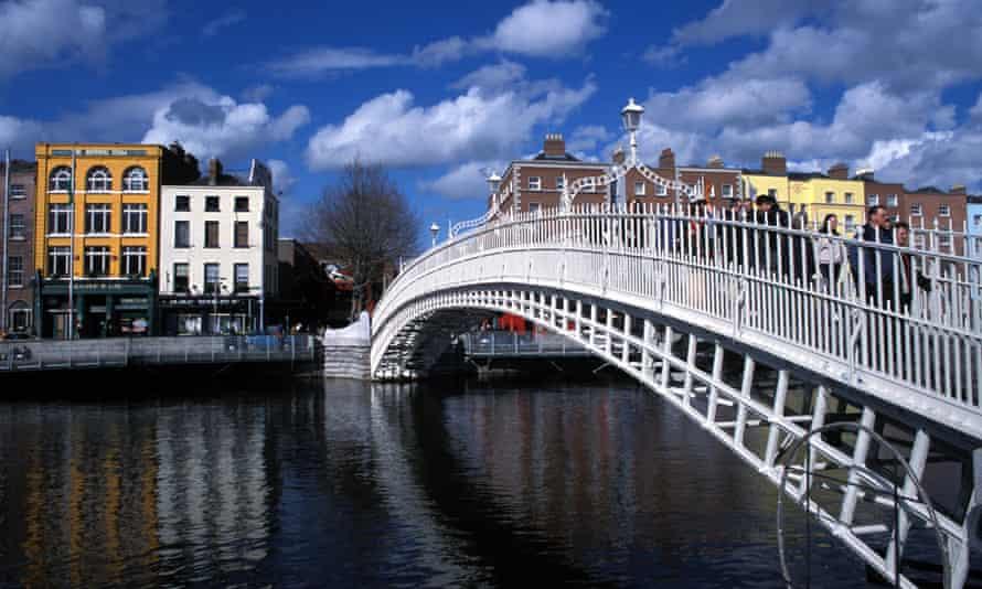 Daytime shot of the Ha'penny bridge that crosses the river Liffey in Dublin