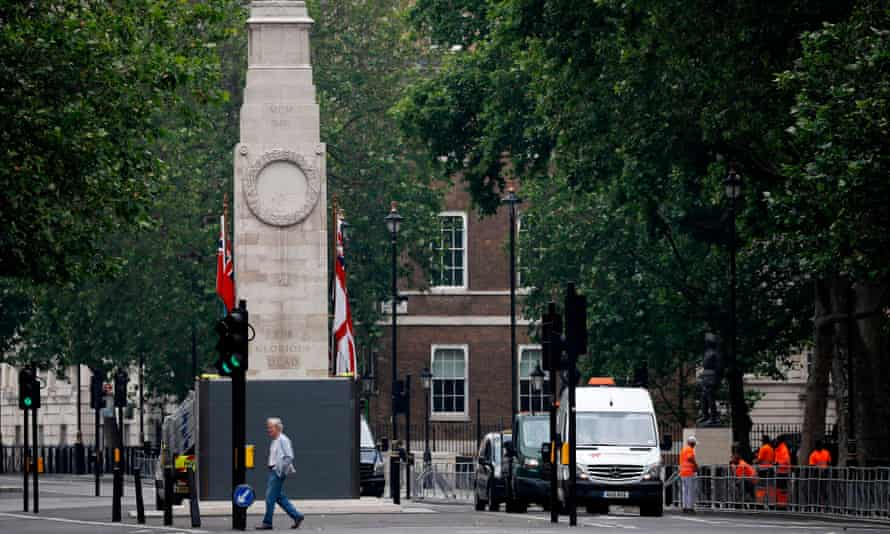 The Cenotaph war memorial in Whitehall, central London, being boarded up on Friday