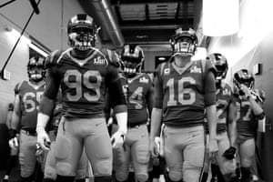 Aaron Donald and Jared Goff lead their team out of the tunnel before the game