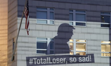 Revenge is tweet: an image of Trump is projected by Greenpeace on to the US Embassy in Berlin after he declared that America was pulling out of the Paris Climate Agreement.
