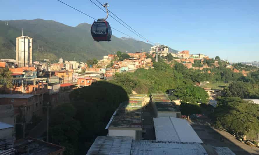 A cable car passes above San Agustín
