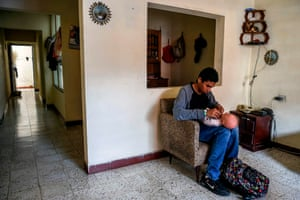 Teenage student Miguel Angel Suarez, takes care of a robot at home