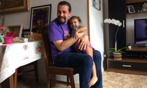 Boulos hugs the niece of murdered Rio councillor Marielle Franco during a recent visit to her family home.
