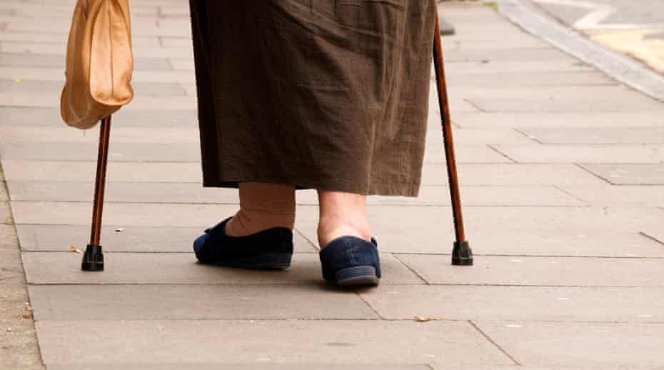 An older woman with walking sticks
