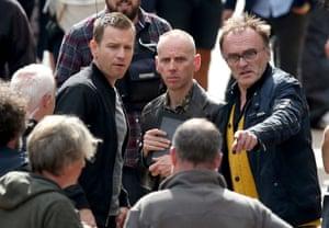 director Danny Boyle, right, with actors Ewan McGregor and Ewan Bremner filming T2 Trainspotting in Edinburgh.