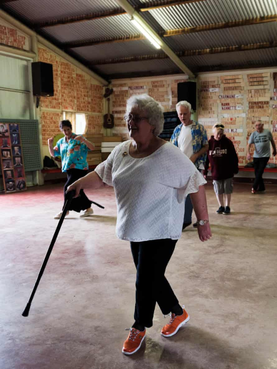 Barbara Hill, 80, teaches the sequence of steps to a class of beginners.