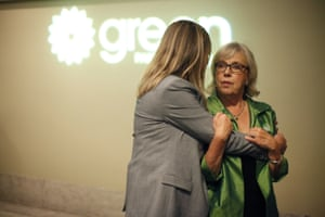 The Green party's chief of staff, Debra Eindiguer (left), who has worked with May (right) for more than 16 years, talks with her as results come in at Crystal Gardens in Victoria