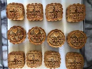 Mooncakes, a traditional Chinese dessert served at the mid-autumn festival, are decorated with police-friendly slogans on the outside. Social media posts showed that the cakes also came with a small note baked inside and the protest slogan: 'Liberate Hong Kong. Revolution of our time.'