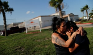 Isabela, an asylum seeker from El Salvador, hugs her 17-year-old daughter Dayana after being reunited with her in Brownsville, Texas.