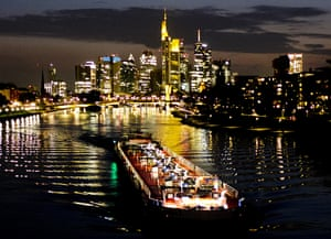 Frankfurt, GermanyA cargo barge is seen on the river Main with bank buildings in background.