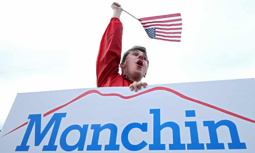 A supporter holds a Manchin sign in Charleston, West Virginia, on 6 November.