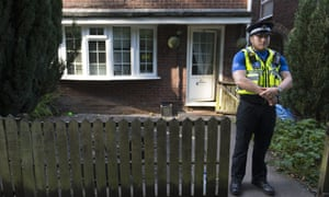 A police officer stands outside a property during a search of a house in Pentwyn, which is believed to be the home of Darren Osborne.