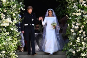 Prince Harry, Duke of Sussex and his wife Meghan, Duchess of Sussex walk down the west steps of St George's Chape