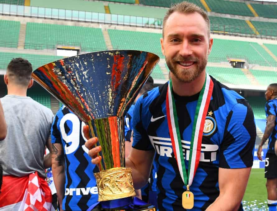 Christian Eriksen celebrates Inter's title win with his medal and the Serie A trophy