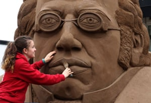 Crail, Scotland. Sculptor Claire Jamieson puts the finishing touches to a huge bust of the composer Franz Schubert, created from 20 tonnes of sand