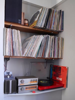 Record player and albums on shelves