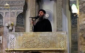 Abu Bakr al-Baghdadi making what would be his first public appearance at a mosque in Mosul, in a still from a video recording posted on the internet on 5 July 2014.