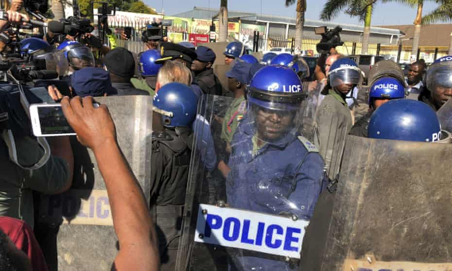Riot police break up an opposition party press conference after Emmerson Mnangagwa gained power in Zimbabwe.