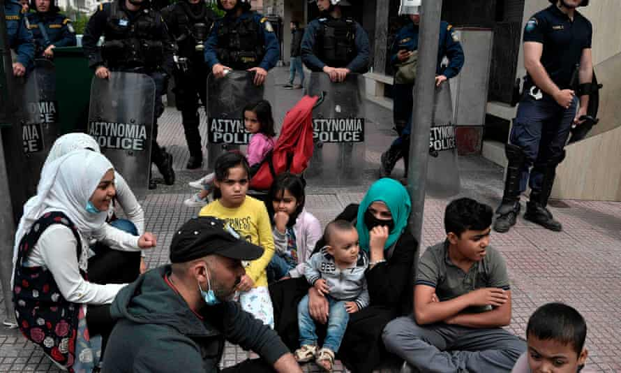 Refugees holding asylum status protest outside the EU offices in Athens