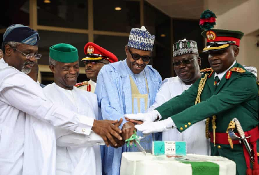 (From left to right) Speaker of the House of Representatives Femi Gbajabiamila, Vice President Yemi Osinbajo, President Muhammadu Buhari and Speaker of the Senate Ahmed Lawan receive some military aid by cutting an anniversary cake during a ceremony commemorating 60 years of independence from the United Kingdom.  on October 1, 2019.